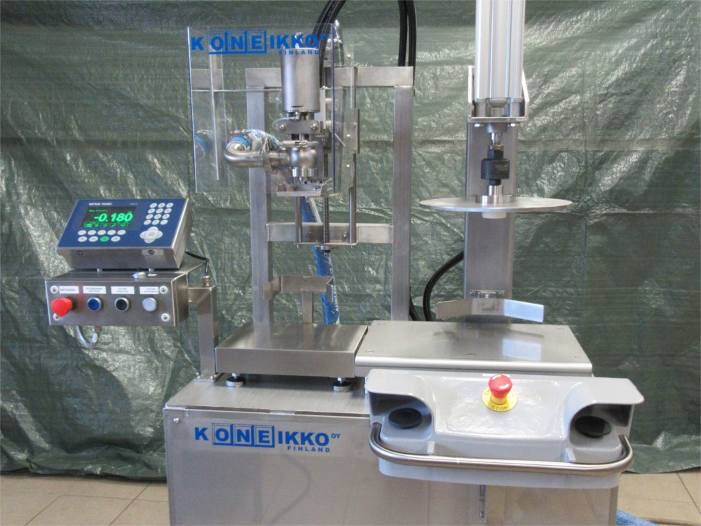 Semi-automatic bucket filling machine